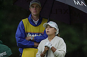 Sat 4th August 2001..Korea's,  Mi Hyun Kim, shelters from the rain at the 11th tee..2001 Weetabix Women's Open, Sunningdale,..[Mandatory Credit Peter Spurrier/ Intersport Images]