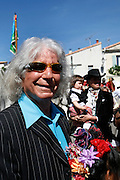 Manitas de Plata - Little hands of Silver - Ricardo Baliardo. Famous Gitan guitarist outside the church surounded by admirers at Saintes Maries de la Mer during the Gypsy pilgrimmage<br /> <br /> Europe, France, Camargue, Saintes Maries de la Mer, Gypsy Pilgrimmage 'Pelerinage des Gitans aux Saintes Maries de la Mer'. Gypsies from all over the world come to celebrate their patron Saint Sara who is carried by them from the church to the sea-shore. May 24th and 25th every year