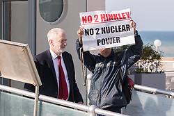© Licensed to London News Pictures . 24/09/2017. Brighton, UK. JEREMY CORBYN leaves the Marr Show pursued by serial protester STUART HOLMES . The first day of the Labour Party Conference in and around The Brighton Centre . Photo credit: Joel Goodman/LNP