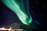 The Aurora Borealis (Northern Lights) at Ersfjordbotn in Tromso, Norway looking like a huge meteor crashing on Earth.