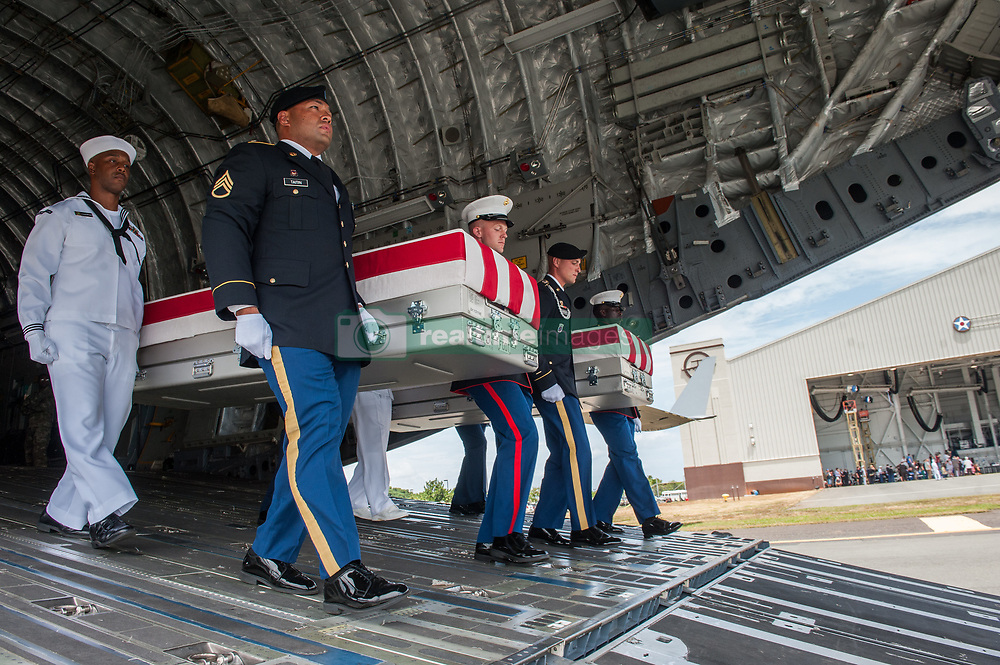 JOINT BASE PEARL HARBOR-HICKAM, Hawaii (Aug. 1, 2018) The honor guard assigned to the U.S. Indo-Pacific Command (INDOPACOM) move a flag-draped case from a U.S. Air Force C-17 Globemaster III aircraft during an honorable carry ceremony at Joint Base Pearl Harbor-Hickam, Hawaii, Aug. 1, 2018. The United Nations Command recently repatriated 55 transfer cases from North Korea that contain what are believed to be the remains of American service members lost in the Korean War. (U.S. Air Force photo by Senior Airman Apryl Hall/Released)180801-F-AN072-0159