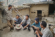 LIANGSHAN, CHINA - MAY 14: (CHINA OUT) <br /> <br /> People talk in Atuler village located at the 800-meter-high cliff on May 14, 2016 in Liangshan Yi Autonomous Prefecture, Sichuan Province of China. 72 families lived in Atuler village on the 800-meter cliff at Meigu River Canyon in Liangshan Yi Autonomous Prefecture. 15 pupils, aged 6 to 15, accompanied by 3 adults regularly spent 2 hours climbing 17 vines ladders hung on the 800-meter-high cliff to go between school and home twice a month. Villagers used the same ladders to go to the nearest market once a week to sell peppers and walnuts and buy necessities. <br /> ©Exclusivepix Media