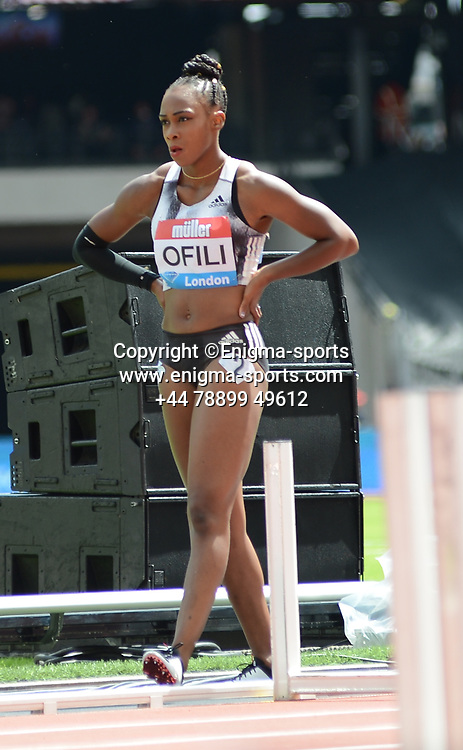 Cindy Ofili competes in the women's 100m hurdles during the IAAF Diamond League at the Queen Elizabeth Olympic Park London, England on 20 July 2019.