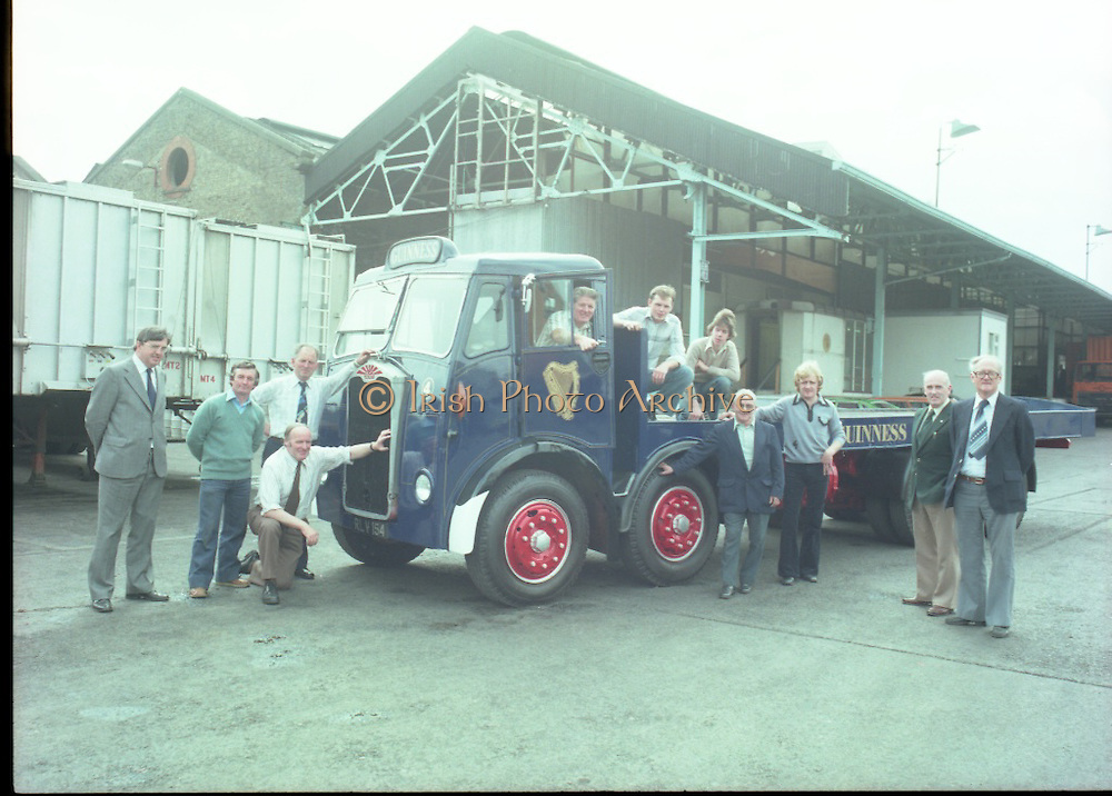 """Handover of Old Guinness Truck.   (M83)..1979..24.07.1979..07.24.1979..24th July 1979..The Albion Truck registration number RLV 154 was officially handed over to the Howth, National Transport Museum today. The vehicle was found in a scrap yard and purchased by the museum. History checking on the vehicle found that it had been part of the Guinness fleet both in Ireland and England. On hearing about the truck Guinness came on board and helped restore the vehicle to its former glory. An  eight wheeler of model type HD57 it is classed as a very rare model. The truck is powered by a six cylinder 'Whispering Giant' engine..Albion were a commercial vehicle builder based in Scotland..To see this and many other rare vehicles The museum is located in the Heritage Depot, Howth Demesne, Howth, Ireland. 60 vehicles are currently in Howth on display. .Image shows some of the staff who were engaged in the refurbishment of the """"Guinness Albion""""."""