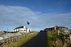 EXCLUSIVE: An Australian man has created his own Outback outpost 11,000 miles from home on the Shetland Islands – and he even has WALLABIES. Tasmanian Dave Kok, 42, has built his own Aussie oasis on the Scottish archipelago after deciding to settle there when he was travelling Europe. Now Dave lives with his Shetland native wife Louise, 38, and two daughters Caitlin, 11, and Ruby, aged four. Social care worker Dave came to the islands in the late 90s and since 2016 has been building his own watering hole choc-full of Australiana on the island of Burra. Dave's place 'The Outpost' is a renovated wooden porta cabin filled with Tasmanian beers, Tim Tams, books on bush craft and Aussie Rules sporting memorabilia. Locals use the Outpost as their local bar and meeting place, as the nearest pub or café is three bridges and three islands away. And visitors can now enjoy the Outpost's wallabies Ned and Kelly who David brought to the island this winter. Based on the Shetland Islands latitude the marsupials could be the most northerly of their species anywhere on the planet. Dave said visiting Australians are often surprised to find the antipodean paradise in such a remote location. 16 Feb 2018 Pictured: Pic from Dave Donaldson/ Magnus News Agency. Pic the Aussie-themed Outpost in the Shetland Islands. An Australian man has created his own Outback outpost 11,000 miles from home on the Shetland Islands – and he even has WALLABIES. Tasmanian David Kok, 42, has built his own Aussie oasis on the Scottish archipelago after deciding to settle there when he was travelling Europe. Now David lives with his Shetland native wife Louise and two daughters Caitlin, 11, and Ruby, aged four. Social care worker David came to the islands in the late 90s and has built his own watering hole choc-full of Australiana on the island of Burra. David's place 'The Outpost' is a renovated wooden porta cabin filled with Tasmanian beers, Tim Tams, books on bush craft and Aussie Rules spor