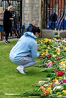 Members of the public leaving Flowers and tributes at the gates of Windsor Castle after The Duke of Edinburgh died, aged 99, Windsor Castle, Windsor, Berkshire, UK.photo by Mark Anton Smith