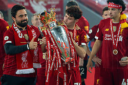 LIVERPOOL, ENGLAND - Wednesday, July 22, 2020: Liverpool's Neco Williams kisses the Premier League trophy as the Reds are crowned Champions after the FA Premier League match between Liverpool FC and Chelsea FC at Anfield. The game was played behind closed doors due to the UK government's social distancing laws during the Coronavirus COVID-19 Pandemic. Liverpool won 5-3. (Pic by David Rawcliffe/Propaganda)