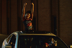 A young girl holds up her arms as protesters pass by Saturday, September 24, 2016 in Charlotte, NC, USA. Protesters came together for the fifth straight night to protest following the fatal shooting of Keith Lamont Scott. Keith Lamont Scott was shot and killed by Charlotte-Mecklenburg Police Officer Brentley Vinson on Tuesday afternoon. Photo by Jeff Siner/Charlotte Observer/TNS/ABACAPRESS.COM