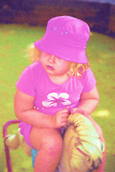 Nursery school girl playing on rocking horse,