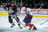 KELOWNA, CANADA - OCTOBER 16: Remi Laurencelle #20 of the Lethbridge Hurricanes is checked by Tyrell Goulbourne #12 of the Kelowna Rockets on October 16, 2013 at Prospera Place in Kelowna, British Columbia, Canada.   (Photo by Marissa Baecker/Shoot the Breeze)  ***  Local Caption  ***