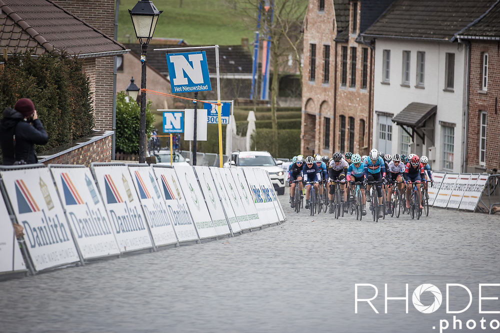 Chasing group riding the Nokereberg cobbles<br /> <br /> 2nd Nokere Koerse WE (BEL) 2021<br /> UCI Women Elite 1.PRO<br /> One Day Race: Deinze > Nokere 124km