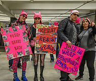 BART and Muni riders arrive at CIVIC Center BART station wearing pink pussy hats and carrying signs for the first Women's March San Francisco.