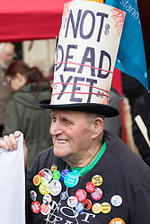"""London, April 16th 2016. A pensioner says """"I'm not dead yet"""" as thousands of people supported by trade unions and other rights organisations demonstrate against the policies of the Tory government, including austerity and perceived favouring of """"the rich"""" over """"the poor""""."""