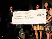 """Chris """"Ludacris"""" Bridges and Felicia Fletcher, Alize Diamond Awardee and Michele Murray, Alize Brand Director presenting $25,000 cheque  at The Ludacris Foundation 5th Annual Benefit Dinner & Casino Night sponsored by Alize, held at The Foundry at Puritan Mill in Atlanta, Ga on May 15, 2008.. Chris """"Ludacris"""" Bridges, William Engram and Chaka Zulu were the inspiration for the development of The Ludacris Foundation (TLF). The foundation is based on the principles Ludacris learned at an early age: self-esteem, spirituality, communication, education, leadership, goal setting, physical activity and community service. Officially established in December of 2001, The Ludacris Foundation was created to make a difference in the lives of youth. These men have illustrated their deep-rooted tradition of community service, which has broadened with their celebrity status. The Ludacris Foundation is committed to helping youth help themselves."""