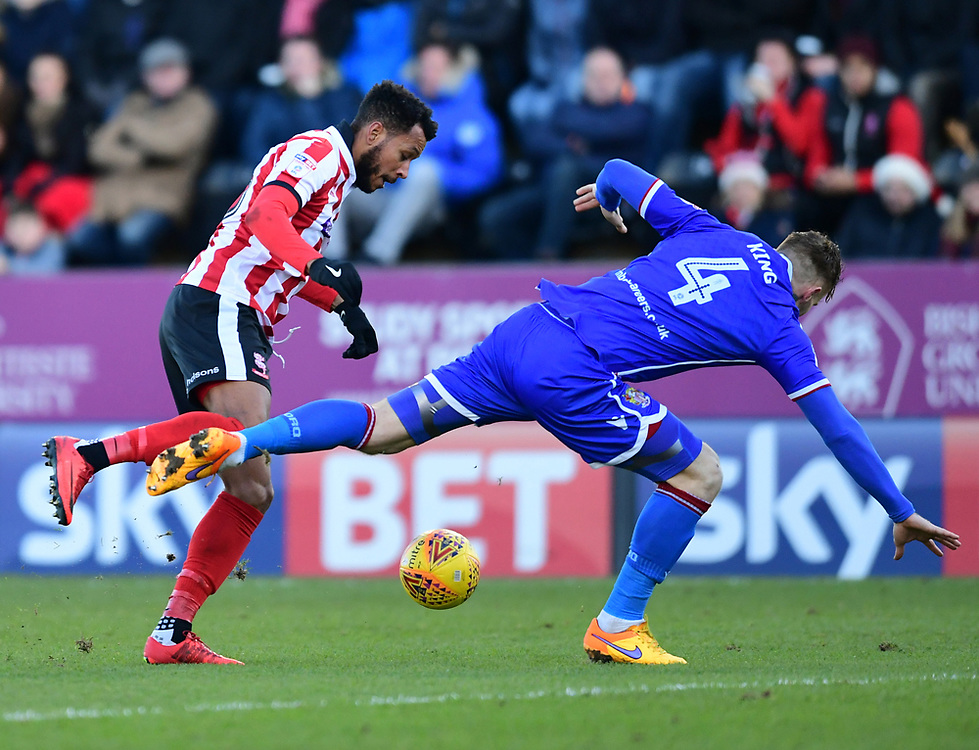 Lincoln City's Matt Green vies for possession with Stevenage's Jack King<br /> <br /> Photographer Chris Vaughan/CameraSport<br /> <br /> The EFL Sky Bet League Two - Lincoln City v Stevenage - Tuesday 26th December 2017 - Sincil Bank - Lincoln<br /> <br /> World Copyright © 2017 CameraSport. All rights reserved. 43 Linden Ave. Countesthorpe. Leicester. England. LE8 5PG - Tel: +44 (0) 116 277 4147 - admin@camerasport.com - www.camerasport.com
