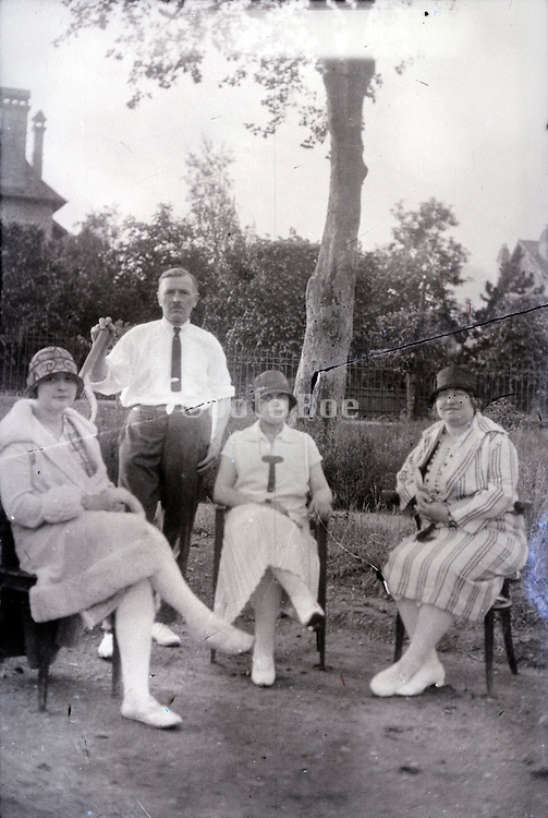 family together in the garden 1930s image with tear