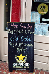 20 April 2015. New Orleans, Louisiana.<br /> A sign for sake in the French Quarter. <br /> Photo; Charlie Varley/varleypix.com