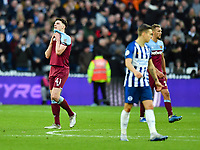 Football - 2019 / 2020 Premier League - West Ham United vs. Brighton & Hove Albion<br /> <br /> West Ham United's Declan Rice dejected s Brighton & Hove Albion's Pascal Groß scores his side's second goal, at The London Stadium.<br /> <br /> COLORSPORT/ASHLEY WESTERN