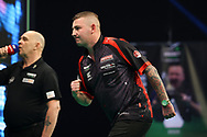 Nathan Aspinall wins his match and celebrates during the Unibet PDC Premier League of darts at Marshalls Arena, Stadium MK, Milton Keynes, England. UK on 7 April 2021.