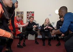 Prince Harry joins a warm up before jogging with volunteers and young homeless people from The Running Charity, at the Depaul Trust Hostel in Willesden, London.