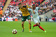 Raheem Sterling of England battles for possession with Egidijus Vaitkunas of Lithuania during the FIFA World Cup Qualifier group stage match between England and Lithuania at Wembley Stadium, London, England on 26 March 2017. Photo by Matthew Redman.