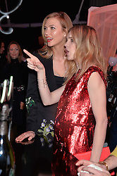 Left to right, KARLIE KLOSS and NATALIA VODIANOVA at The Naked Heart Foundation's Fabulous Fund Fair hosted by Natalia Vodianova and Karlie Kloss at Old Billingsgate Market, 1 Old Billingsgate Walk, London on 20th February 2016.