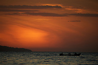 Sunset over the Contreras Islands, Coiba National Park, as viewed from Pixvae.  With local fishing boat passing.