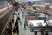 Commuters disembark a train at a subway station in Taipei, Taiwan.