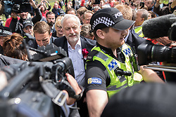 © Licensed to London News Pictures . 07/06/2017. Runcorn , UK. Labour Party leader Jeremy Corbyn is lead away by police and close protection officers after he holds a campaign rally in Runcorn, on the final day of the General Election campaign ahead of polls opening tomorrow (8th July 2017) . Photo credit: Joel Goodman/LNP