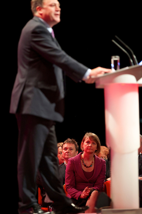 Yvette Cooper, looks on as husband Ed Balls addresses delgates attending the Labour Party Conference in Manchester on 29 September 2010, the penultimate day of annual assembly.