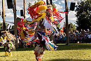 Native Americans dancers from the Arapahoe people dressed in traditional costumes perform a fancy dance at the Indian Village during Cheyenne Frontier Days July 25, 2015 in Cheyenne, Wyoming. Frontier Days celebrates the cowboy traditions of the west with a rodeo, parade and fair.