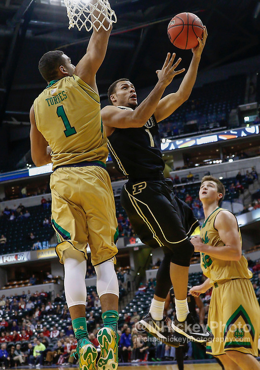 INDIANAPOLIS, IN - DECEMBER  20: Bryson Scott #1 of the Purdue Boilermakers shoots the ball against Austin Torres #1 of the Notre Dame Fighting Irish at Bankers Life Fieldhouse on December 20, 2014 in Indianapolis, Indiana. Notre Dame defeated Purdue 94-63. (Photo by Michael Hickey/Getty Images) *** Local Caption *** Bryson Scott; Austin Torres