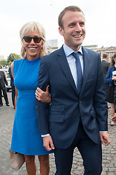 French Minister of the Economy, Industry and the Digital Sector Emmanuel Macron and his wife Brigitte Trogneux during the 2015 annual Bastille Day military parade on Place de la Concorde square in Paris, France on July 13, 2015. President Pena Nieto is on a three-day state visit to France. Photo by Thierry Orban/ABACAPRESS.COM  | 509116_017 Paris France