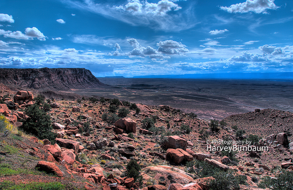 Grand Canyon from Hywy 89 Nth Rim. Dramatic Blue cumulus clouds, red sandstone buttes.