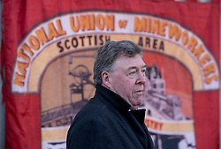 Pictured: Mick McGahey's son Michael McGahey speaking at the wreath laying.<br /> <br /> Labour MSP's and National Union of Mineworkers (NUM) campaigners laid wreaths and held a short vigil outside the Scottish Parliament. Speakers included Scottish Labour leader Richard Leonard, NUM president Nicky Wilson and Mick's son, Michael MxGahey.<br /> <br /> © Dave Johnston / EEm