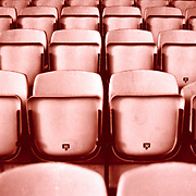 row after row of red footbal stand chairs