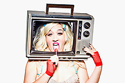 Various Characters all with an old TV over their heads so that their faces can be seen in the screen.  Like they're actually being televised live.