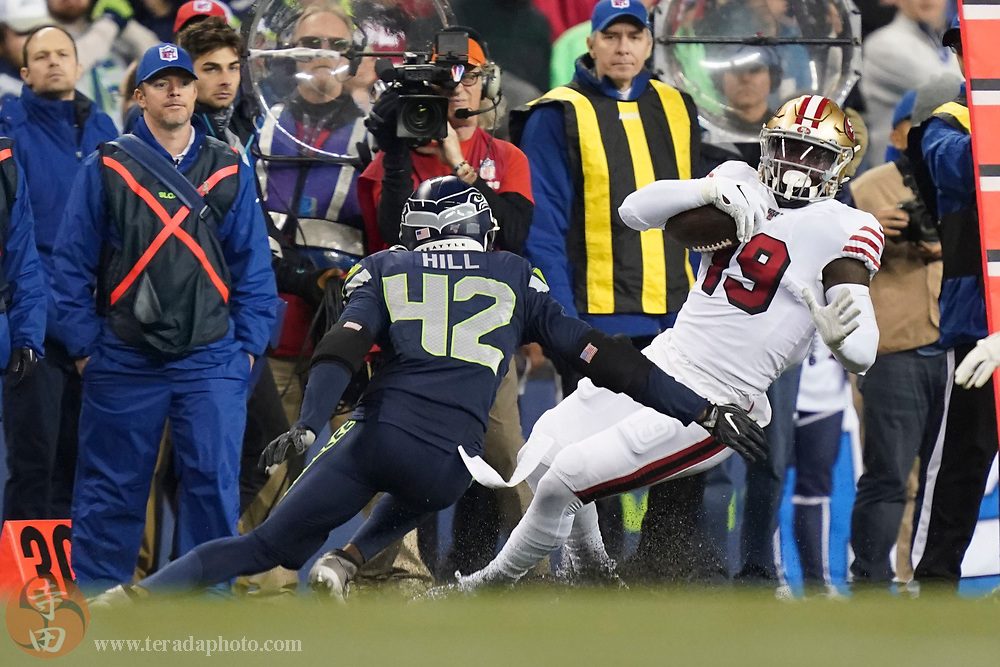 December 29, 2019; Seattle, Washington, USA; San Francisco 49ers wide receiver Deebo Samuel (19) runs against Seattle Seahawks defensive back Lano Hill (42) during the second quarter at CenturyLink Field.