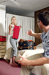 Couple unpacking in a retro hotel room