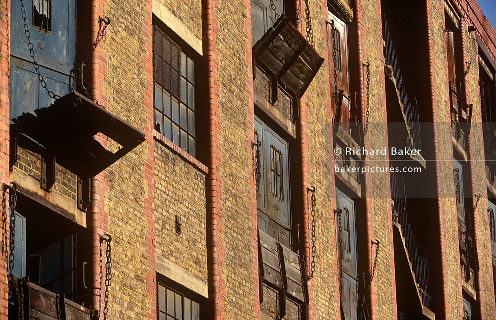 The still-semi derelect Butler's Wharf, 19th century Thameside warehouses, before its renovation and redevelopment later that decade, on 11th September 1993, on the River Thames, London, England.