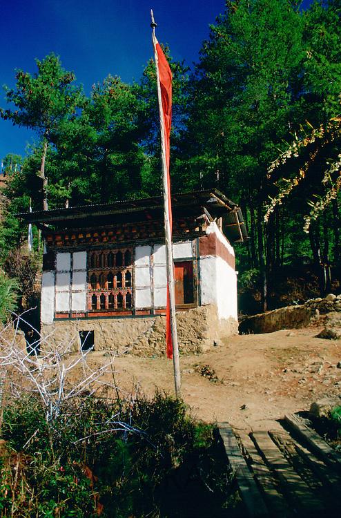 Farmer's home with prayer flags, Bhutan