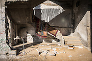 Carpets drying in a destroied building in Shejaiya