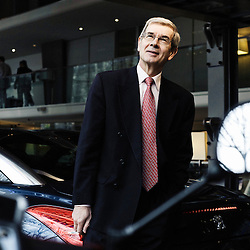 PARIS, FRANCE. JANUARY 7, 2011. Philippe Varin, Peugeot PSA's ceo at their headquarter in Paris. He's posing next to the Peugeot RCZ, a compact 2+2 coupe. (photo: Antoine Doyen)