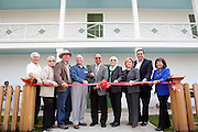 From left to right, Richard Santos, April Halberstadt, Roger Skuse, Jim Foran, Mayor Jose Esteves, Althea Polanski, Debbie Giordiano, Armando Gomez, and Carmen Montano pose for a portrait during the Alviso Adobe Park opening ceremony at Alviso Adobe Park in Milpitas, California, on March 16, 2013. (Stan Olszewski/SOSKIphoto)