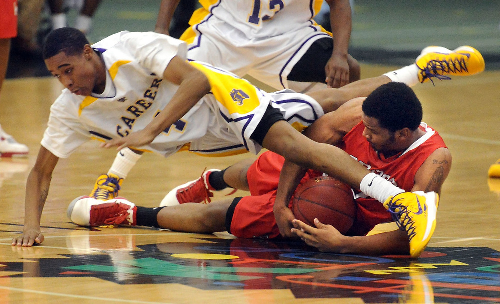 Career vs. Wilbur Cross at the Floyd Little Athletic Center, New Haven. Career's Tyreek Perkins tangles with Cross' Justin Fredlaw. Mara Lavitt/New Haven Register<br /> <br /> 1/17/13