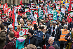 """London, April 16th 2016. Protesters placards and banner create a dense, colourful display as thousands of people supported by trade unions and other rights organisations demonstrate against the policies of the Tory government, including austerity and perceived favouring of """"the rich"""" over """"the poor""""."""
