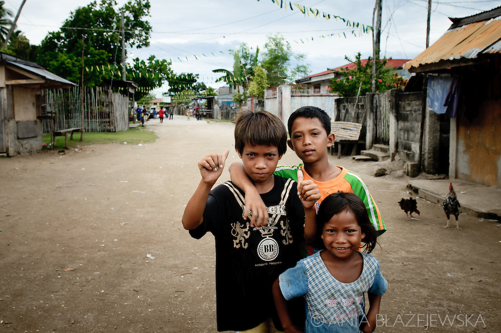 Philippines, Tawi Tawi. Three children from Simunul Island on the main street in the village.