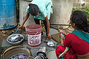 Villagers wash their dishes in bore well water in Gorikathapalli, a remote village in Warangal, Telangana, India, on 22nd March 2015. Safe Water Network works with local communities that live beyond the water pipeline to establish sustainable and reliable water treatment stations within their villages to provide potable and safe water to the communities at a nominal cost. Photo by Suzanne Lee/Panos Pictures for Safe Water Network