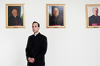 ROME, ITALY - 6 MARCH 2013: (L-R) Seminarian James Platania, 30 years old from Vernon, NJ,  poses for a portrait in front of portaits of the former Rectors (the 2 starting from the left, are Cardinal Edwin F. O'Brien - Rector from 1990 to 1994, and   Cardinal Timothy M. Dolan, Rector from 1994 to 2001, both of which will participate at the Conclave starting March 12th, 2013)  at the Pontifical North American College in Rome, Italy, on March 6, 2013. James Platania is attending the 4th year of studies at the Pontifical North American College...The Pontifical North American College is a Roman Catholic educational institution that forms seminarians for priestly ministry in the dioceses in the United States and that provides a residence for American priests pursuing graduate studies...Gianni Cipriano for The New York Times10139468AROME, ITALY - MARCH 10: U.S. Cardinal Timothy Dolan of New York City arrives at the Our Lady of Guadalupe church in the Monte Mario district where he is the titular head to give a Sunday Mass, in Rome, Italy, on March 10, 2013. Cardinals are set to enter the conclave to elect a successor to Pope Benedict XVI after he became the first pope in 600 years to resign from the role. The conclave is scheduled to start on March 12 inside the Sistine Chapel and will be attended by 115 cardinals as they vote to select the 266th Pope of the Catholic Church...Gianni Cipriano for The New York Times