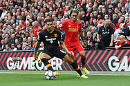 Jake Livermore of Hull City gets in front of Roberto Firmino of Liverpool. Premier League match, Liverpool v Hull City at the Anfield stadium in Liverpool, Merseyside on Saturday 24th September 2016.<br /> pic by Chris Stading, Andrew Orchard sports photography.